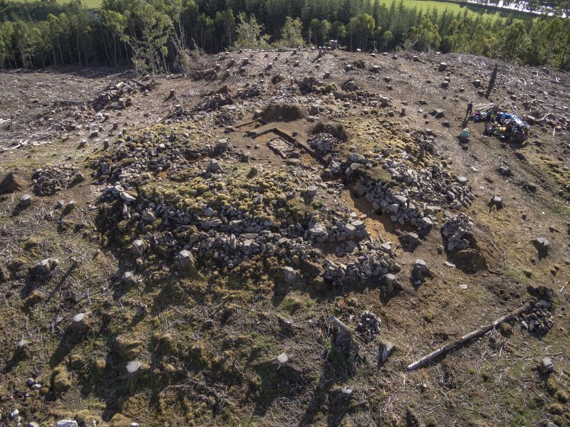 Post-excavation aerial photograph of Trench 1 by Ed Martin, looking south east over the W side of the dun (Trench 1); image shows the curvilinear outer wall face alignment, Comar Wood Dun, Cannich, Strathglass