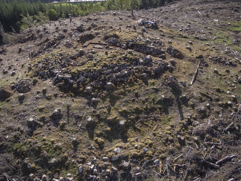 Post-excavation aerial photograph of the dun by Ed Martin, looking South south east over the north side of the dun; image shows the exposed outer wall face in the north west quadrant, Comar Wood Dun, Cannich, Strathglass