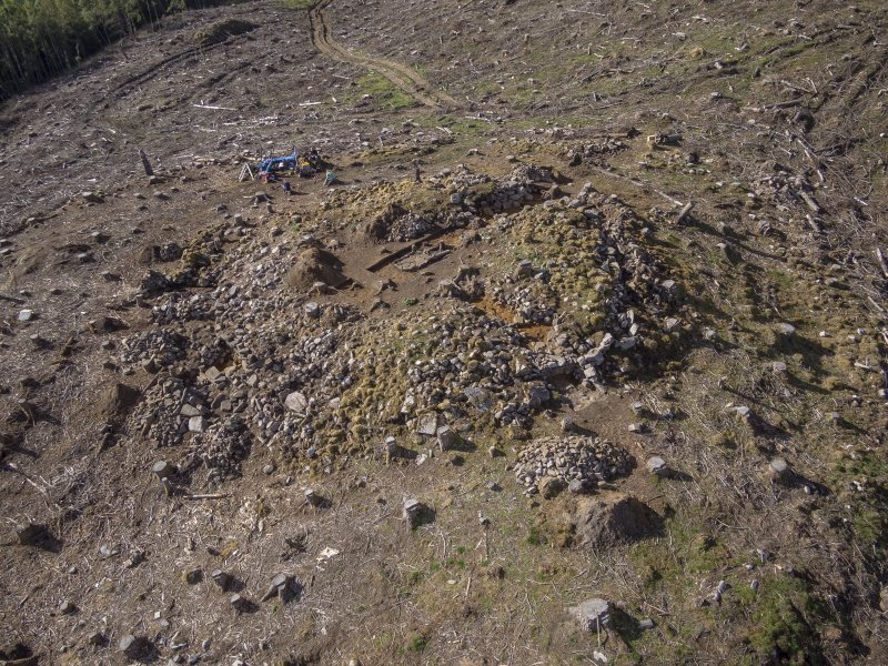 Post-excavation aerial photograph of the dun by Ed Martin, looking south west over the north side of the dun and Trench 2; image shows the exposed outer wall face in Trench 2 and the poorly defined outer wall face in the north east quadrant, Comar Wood Dun, Cannich, Strathglass