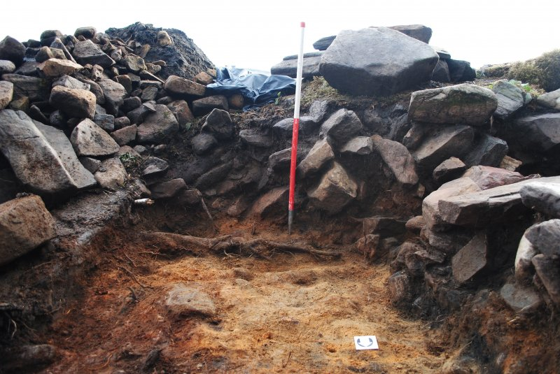 North facing section of Trench 1, south extension; image shows the rubble and soil fill inside the dun walls, Comar Wood Dun, Cannich, Strathglass