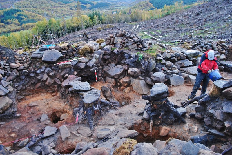 Looking over the postholes and down the entrance passage; image shows the north facing section of Trench 1, Comar Wood Dun, Cannich, Strathglass