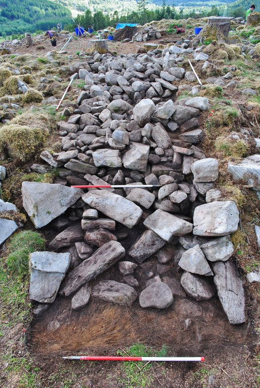 Looking over Trench 2 after initial clean-back - showing the outer face just visible below the rubble spread on the outside of the dun, Comar Wood Dun, Cannich, Strathglass