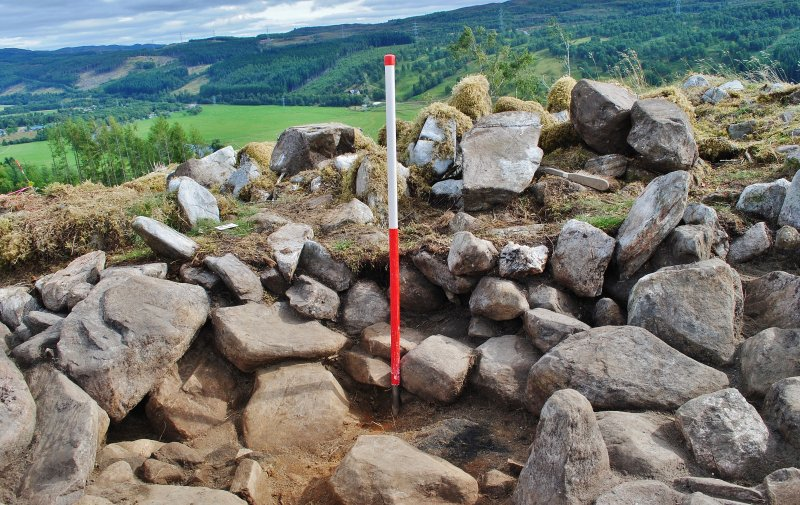 North west facing trench section - showing rubble and soil in section over the dun structure, Comar Wood Dun, Cannich, Strathglass