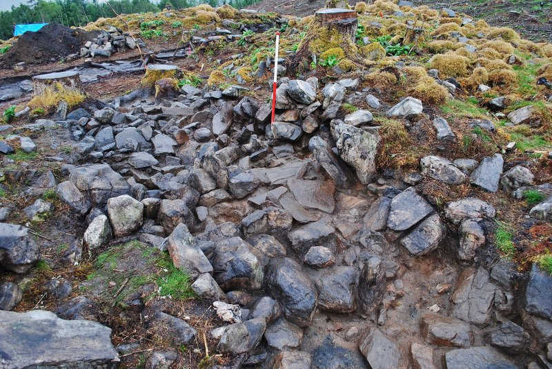Mid-excavation photo of the south half of the Trench 2 east-south-east facing trench section, Comar Wood Dun, Cannich, Strathglass