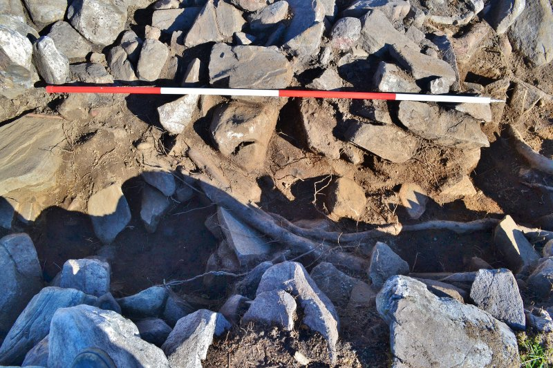 Mid-excavation image of rubble at south end of trench, Comar Wood Dun, Cannich, Strathglass