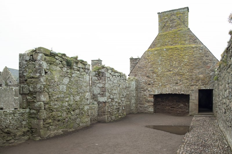 North range. 1st floor. Marischal Suite. East gable with fireplace and doorway.