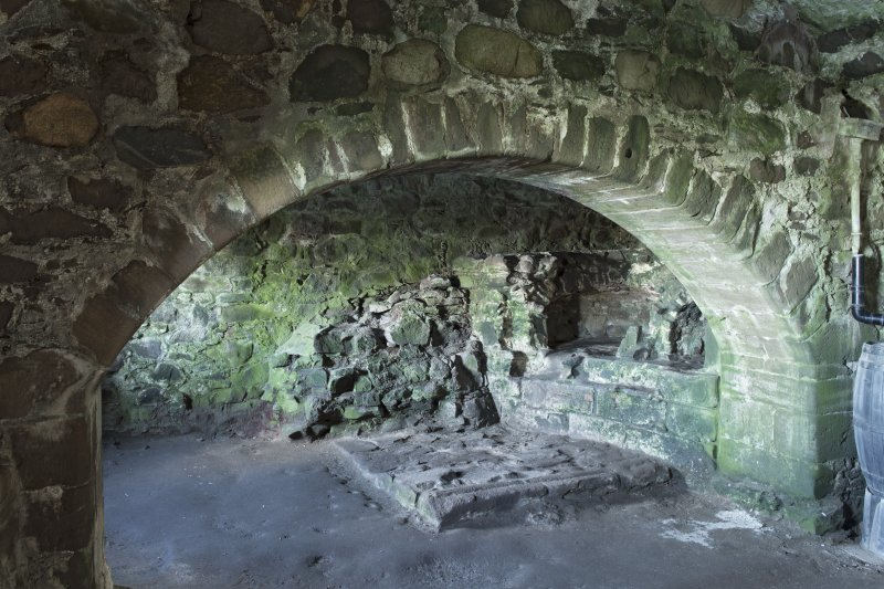 North range. Ground floor. Kitchen. Archway with ovens beyond.