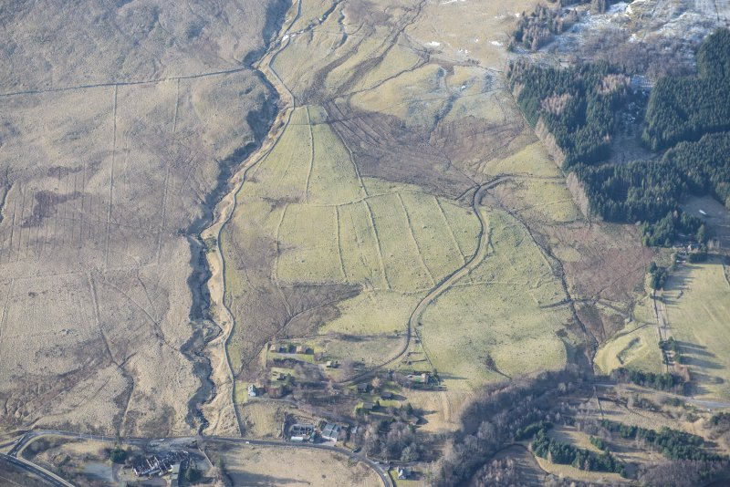 Oblique aerial view of the field system and rig and furrow to the SW of Spittal of Glenshee, looking SSW.