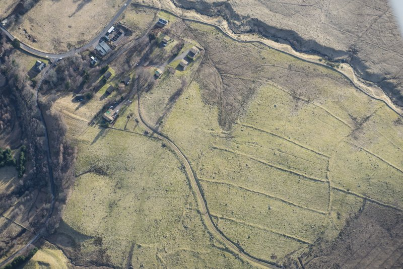 Oblique aerial view of the field system and rig and furrow to the SW of Spittal of Glenshee, looking SE.