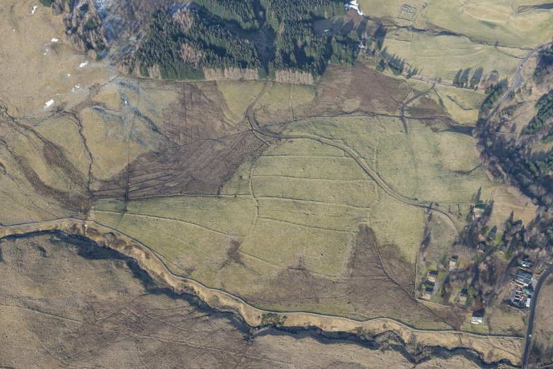 Oblique aerial view of the field system and rig and furrow to the SW of Spittal of Glenshee, looking NW.