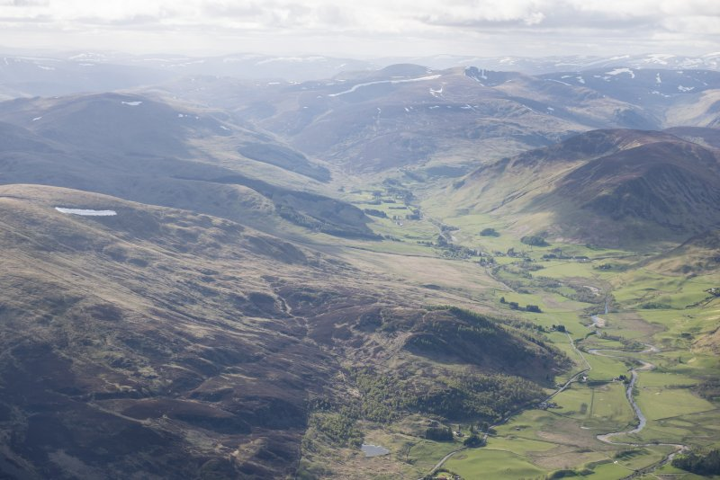 General oblique aerial view of Glen Shee with Spittal of Glenshee and Dalmunzie House in the distance, looking NW.