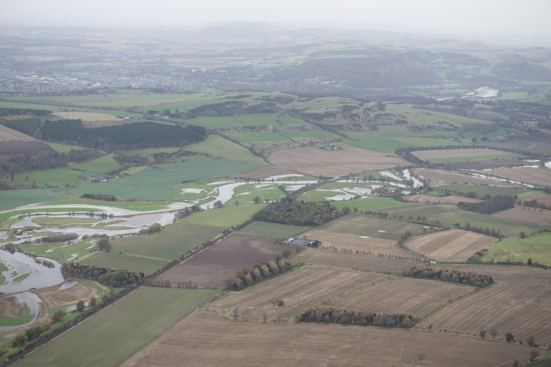 General oblique aerial view of the flooding along the River Earn with Perth in the distance, looking NE.