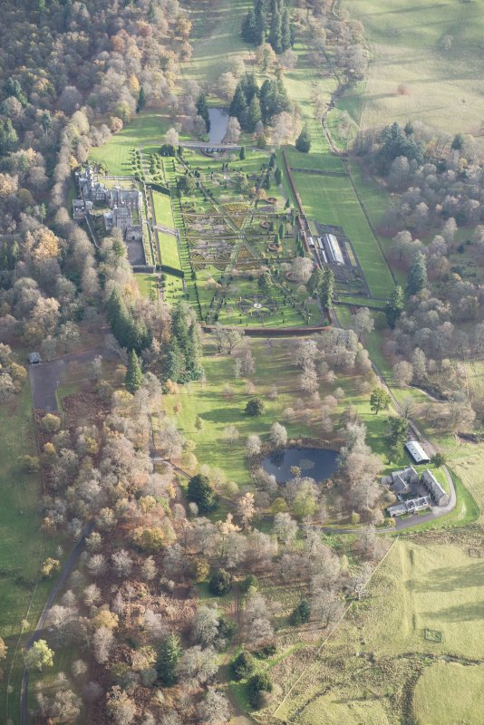 Oblique aerial view of Drummond Castle, looking E.