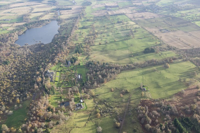 Oblique aerial view of Drummond Castle and policies, looking E.