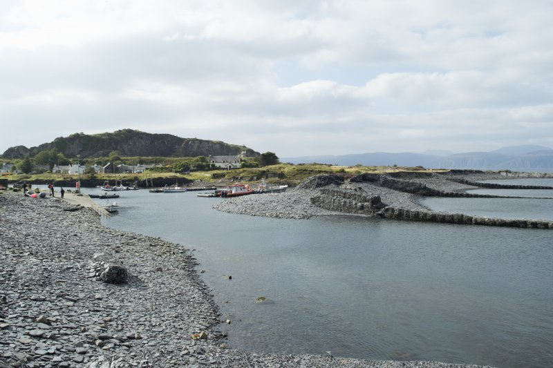 Harbour and shingle beach with gabion slate filled piers, view from east