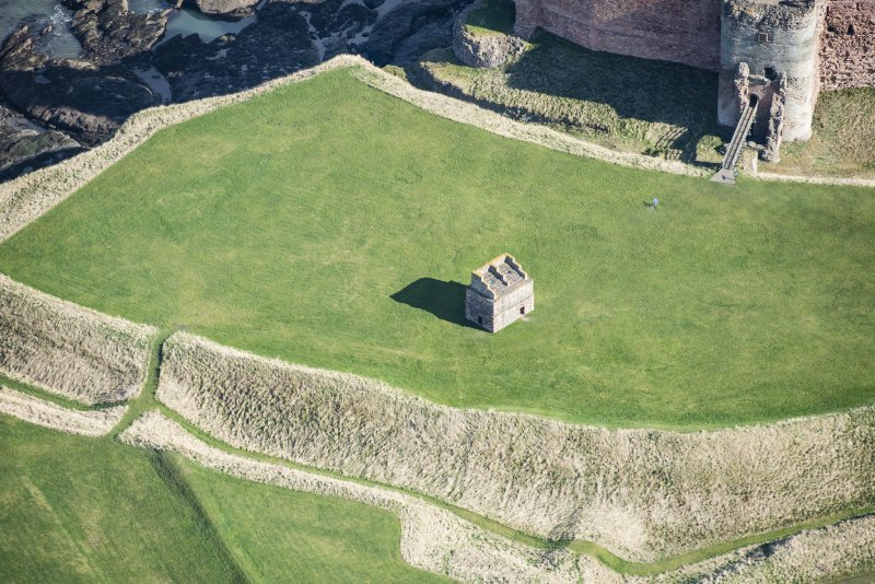 Oblique aerial view of Tantallon Castle centred on the dovecot, looking NE.