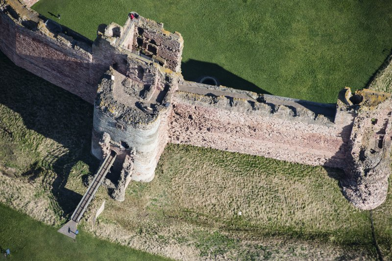 Oblique aerial view of the Mid Tower and East Tower at Tantallon Castle, looking NE.