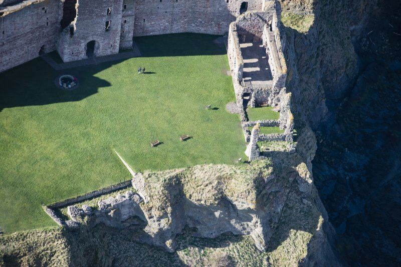 Oblique aerial view of the west wing of Tantallon Castle, looking WSW.