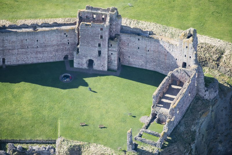 Oblique aerial view of the Mid Tower and the Douglas Tower at Tantallon Castle, looking SSW.
