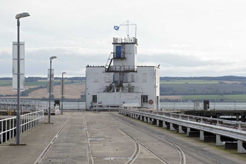 Control tower at end of pier, general view from north. Rail lines for greight traffic  also visible.