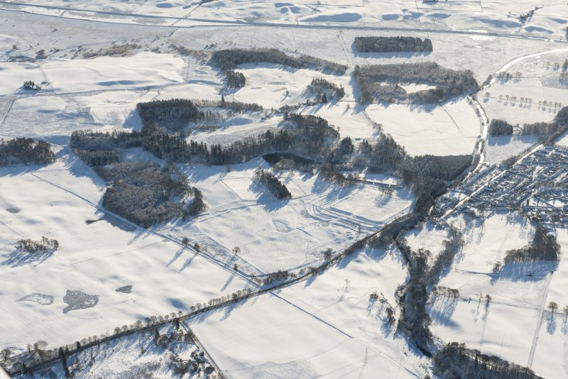Oblique aerial view of the Roman fort at Ardoch, looking SSE.