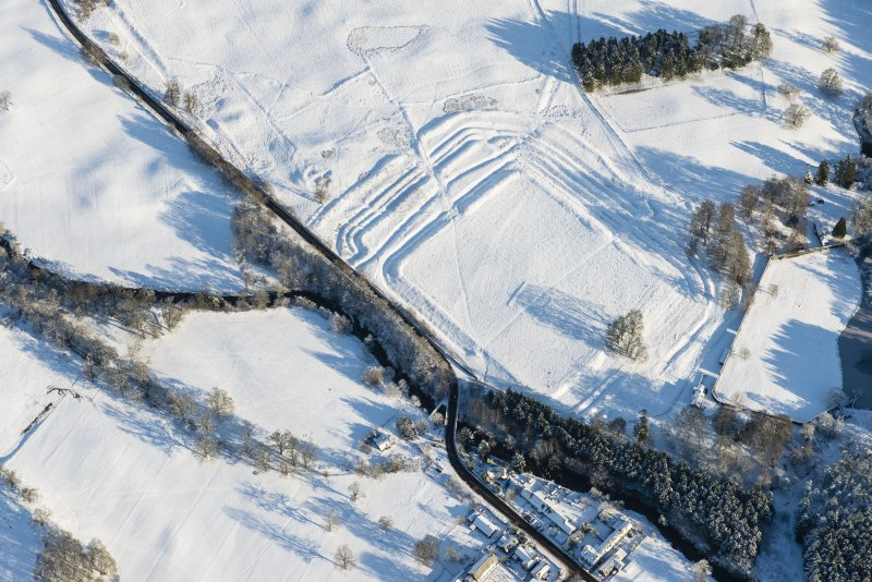 Oblique aerial view of the Roman fort at Ardoch, looking NE.