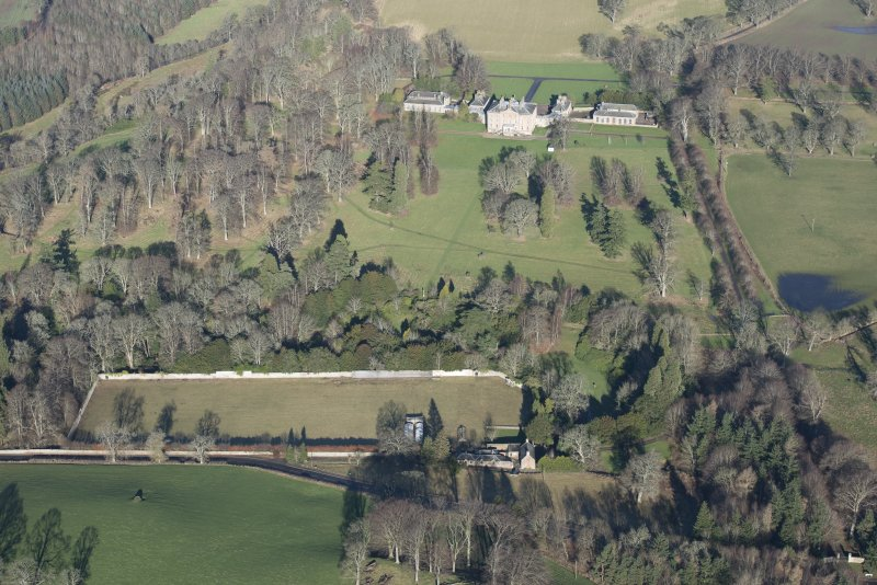 Oblique aerial view of Arniston House and walled garden, looking NNW.