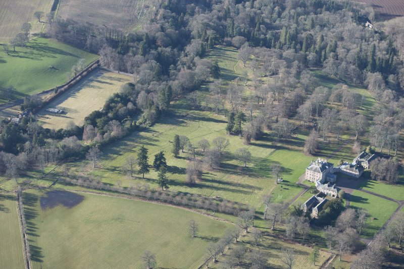 Oblique aerial view of Arniston House and walled garden, looking SW.