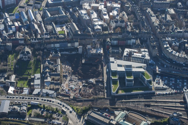 Oblique aerial view of the Caltongate Development and Waverley Court, looking SSE.
