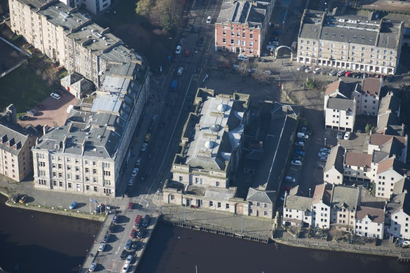 Oblique aerial view of Custom House and Stables, looking W.