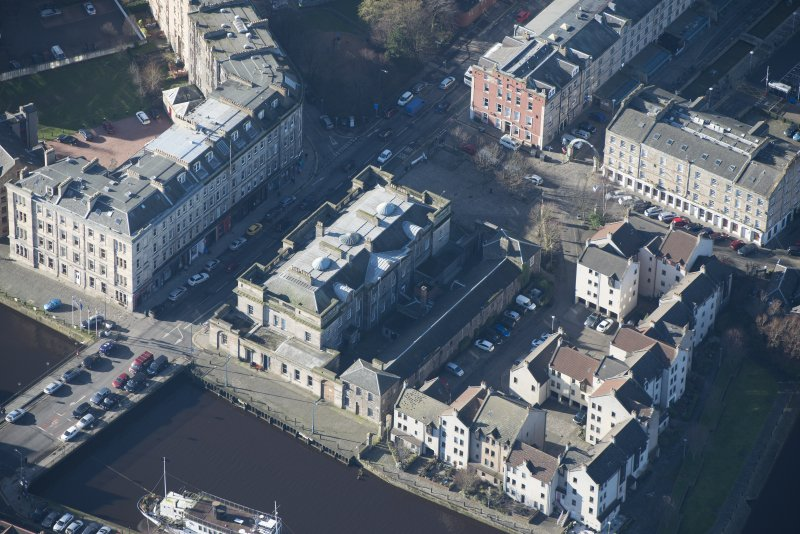 Oblique aerial view of Custom House and Stables, looking WSW.