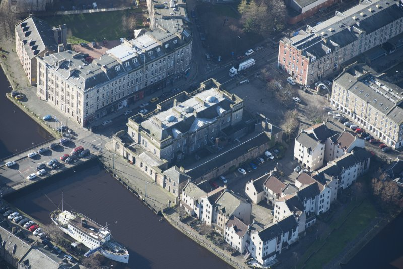 Oblique aerial view of Custom House and Stables, looking SW.