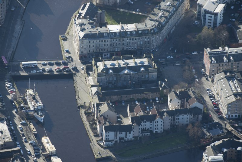 Oblique aerial view of Custom House and Stables, looking SSW.