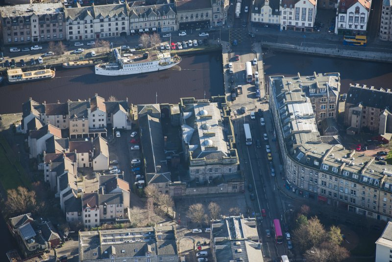 Oblique aerial view of Custom House, Stables and Bernard Street Bridge, looking ESE.