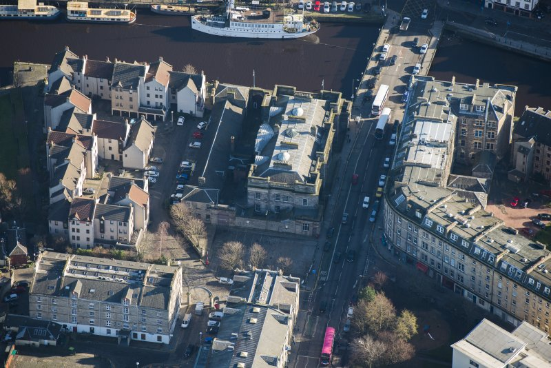 Oblique aerial view of Custom House and Stables, looking E.