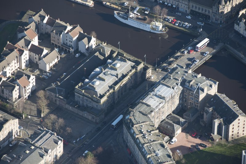 Oblique aerial view of Custom House and Stables, looking NE.