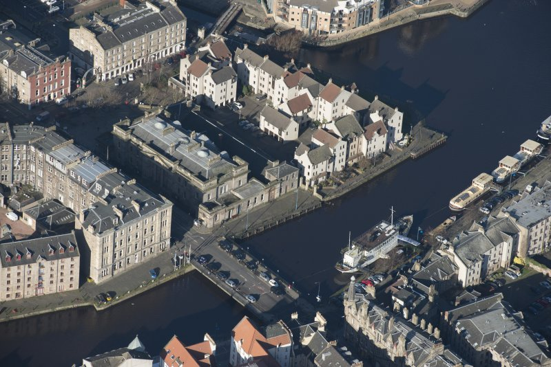 Oblique aerial view of Custom House, Stables and Bernard Street Bridge, looking NW.