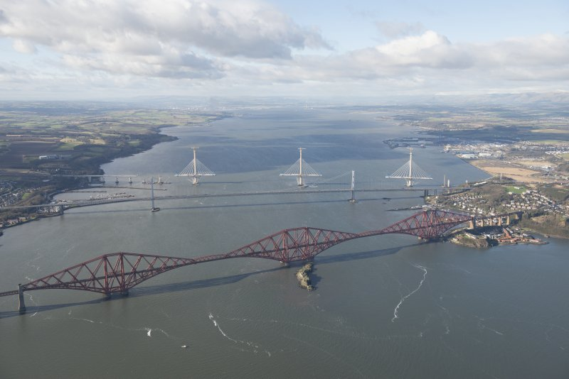 Oblique aerial view of the Forth Road Bridge, Forth Bridge and Queensferry Crossing, looking W.