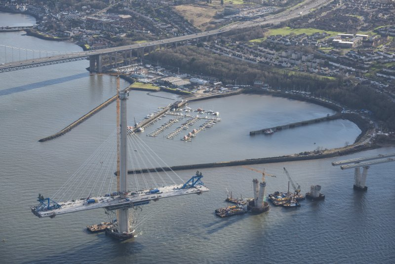 Oblique aerial view of the south tower of the Queensferry Crossing and Port Edgar, looking ESE.
