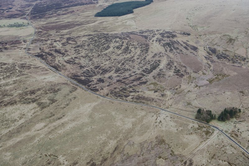 Oblique aerial view of military remains, tracks and rig and furrow at Sheriff Muir, looking NE.