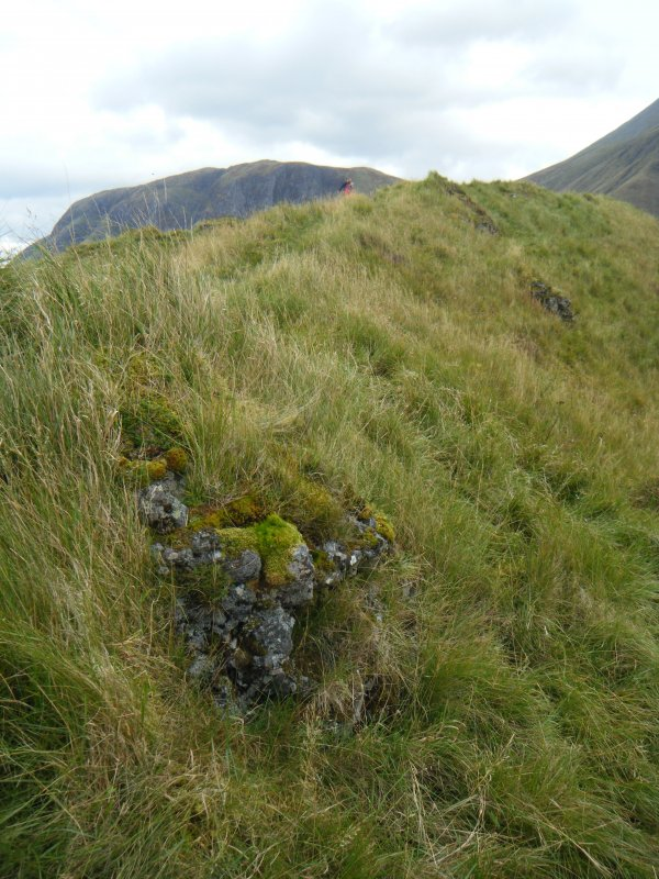 Vitrified block on outside of S rampart near south west corner of fort, photograph of Dun Deardail, from a topographic archaeological survey at five Pictish Forts in the Highlands