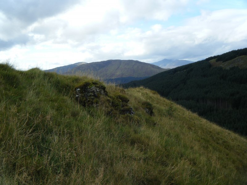 Vitrified blocks of masonry along outside of north rampart, photograph of Dun Deardail, from a topographic archaeological survey at five Pictish Forts in the Highlands