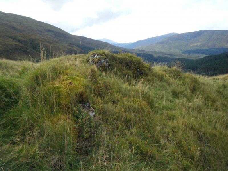 Vitrified block of masonry on north rampart, photograph of Dun Deardail, from a topographic archaeological survey at five Pictish Forts in the Highlands