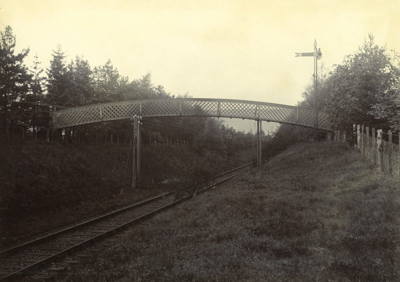 View of footbridge across railway line, Peebles Hydro