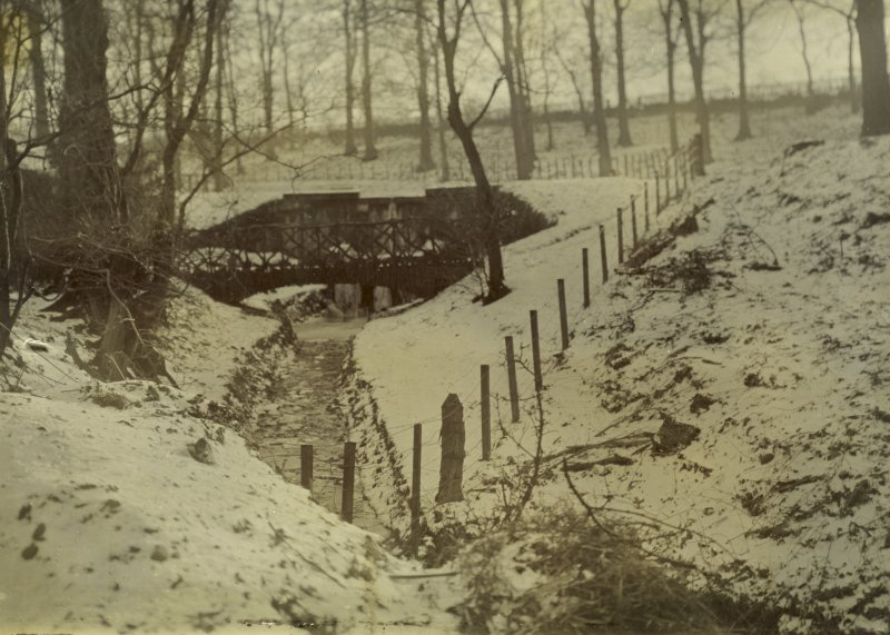 General view of snow-covered grounds showing foot bridge, The Peel, Busby