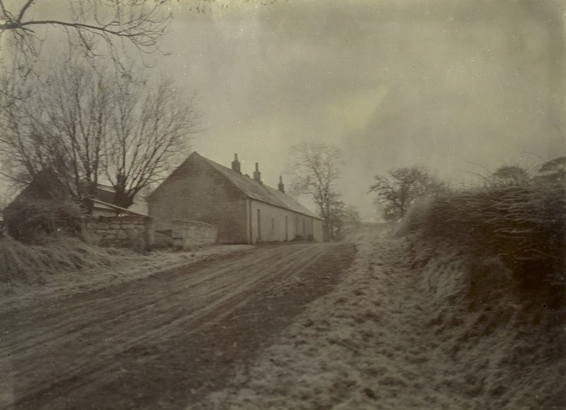 General view of cottages and snow-covered ground, possibly near The Peel, Busby