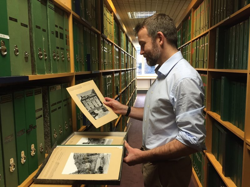 Philip Graham looking at photographs in the HES Search Room at John Sinclair House, 16 Bernard Terrace, Edinburgh