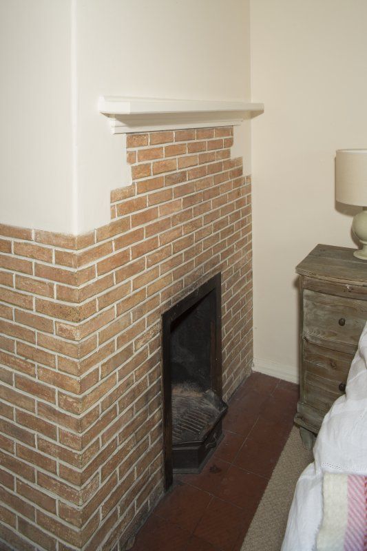 First Floor. Guest Room 1. Detail of fireplace.
