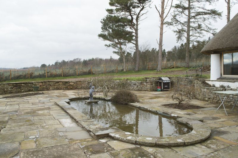 Garden front. View of pond from east.