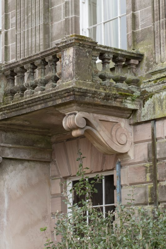 Entrance front. Central bay. Detail of corbel.